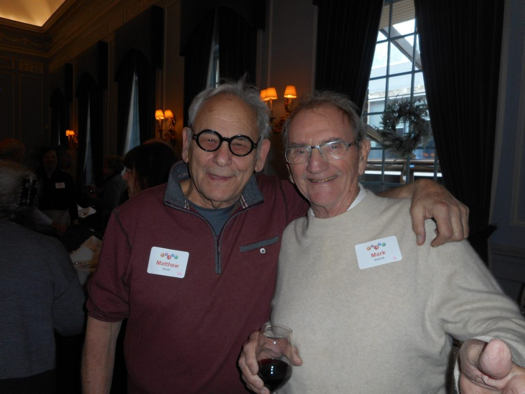 Matt Segal and Mark Abbott toasting the season at the Dec 2017 Holiday Luncheon at the Faculty Club